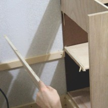 He cut the side out of the inner cabinet to make additional shelving! I'm impressed!