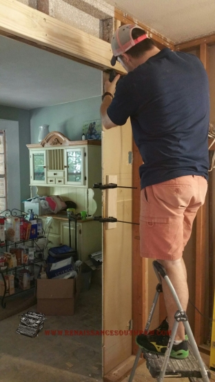 He also had to move the doorway over between the kitchen and the living room due to the size of our refrigerator. I certainly did't know he knew how to do this! He amazes me every day!!